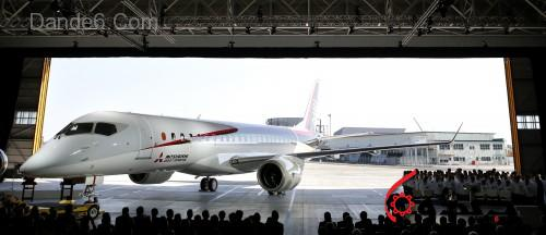The Mitsubishi Regional Jet (MRJ) passenger aircraft, developed by Mitsubishi Aircraft Corp., is unveiled during a rollout ceremony at Mitsubishi Heavy Industries Ltd.'s Nagoya Aerospace Systems Works Komaki South Plant in Toyoyama, Aichi Prefecture, Japan, on Saturday, Oct. 18, 2014. Japan unveiled its first passenger jet today after a delay of almost four years, with a helping hand from bullet-train specialists as it prepares for test flights next year. Photographer: Kiyoshi Ota/Bloomberg